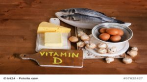 Foods containing vitamin D on a wooden background. View from above