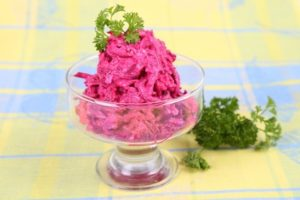 Beet salad with sour cream and garlic on the table